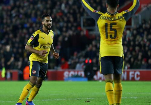 Arsenal's Theo Walcott and Alex Oxlade-Chamberlain celebrate