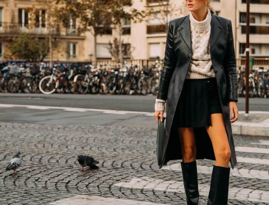 woman wearing a long leather coat