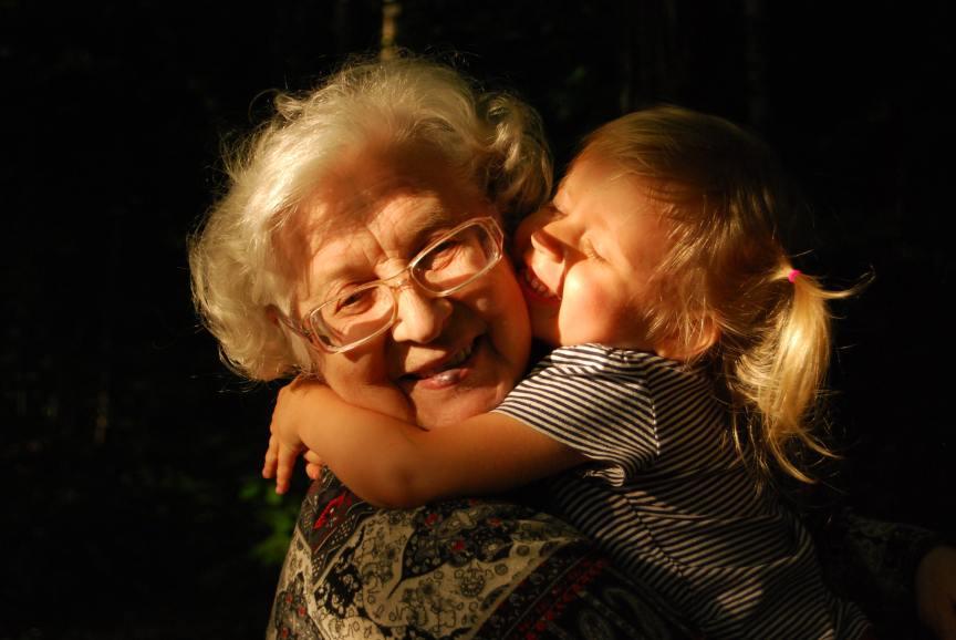 toddler hugging an older woman