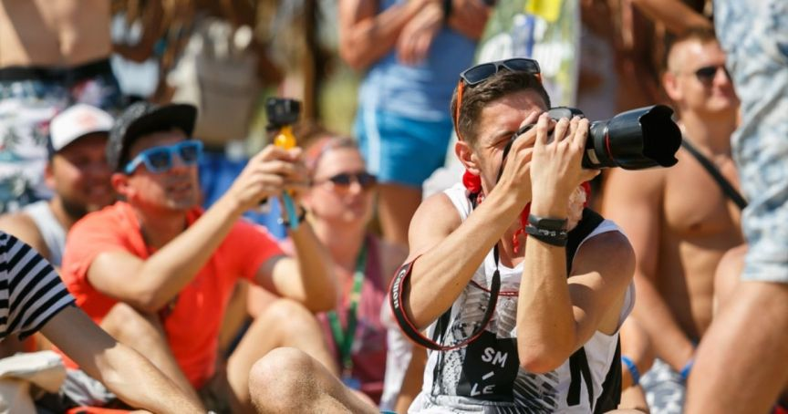 Event photographer trying to get the best shots for event content without bothering guests