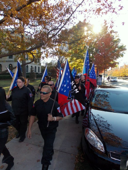 Members of the National Socialist Movement and the Ku Klux Klan arrive at Old City Hall.