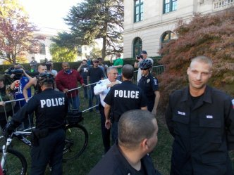 A neo-Nazi listens to a counter-protester as he throws insults and threats.