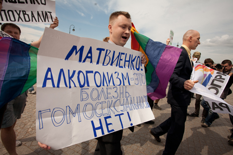 "Nikolay Alekseev, a leading Russian LGBT activist, lawyer and journalist, in the St. Petersburg Pride march on June 29, 2013. His sign reads: ""Matviyenko! [Valentina Matviyenko, a high-ranking Russian politician from St. Petersburg and outspoken LGBT rights opponent] Alcoholism is an illness, homosexuality is not!"" Photo Credit: Valentine Egorshin."