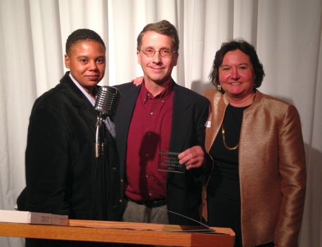 Guild Vice President Jai Taylor, left, and Guild President Teresa Davis, right, with Bert Woodard, who accepted the Person of the Year award on behalf of Wesley Mancini.
