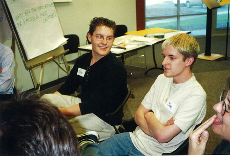 Individuals in this undated photograph from a community center planning meeting.