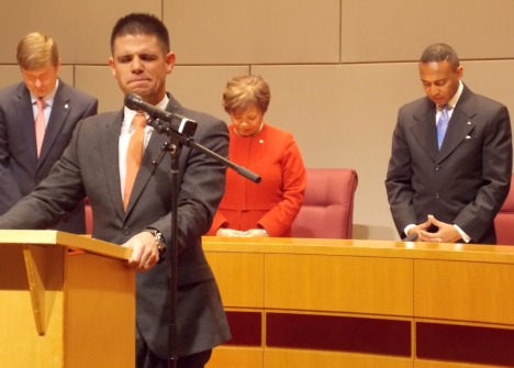 Pastor Steven Furtick, in foreground, of the anti-LGBT Elevation Church leads the closing prayer at the Council swearing-in on Monday. Furtick appeared at the invitation of newly-installed Mayor Patrick Cannon, at right.