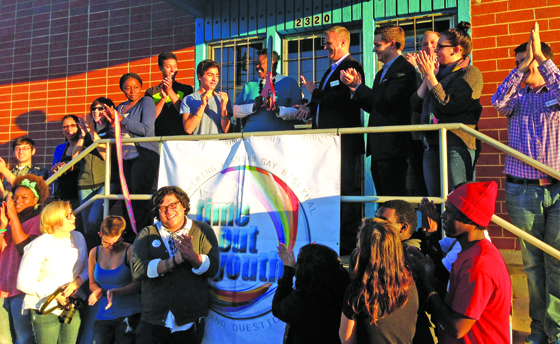 Youth, volunteers, board members and supporters gathered for Time Out Youth's grand opening on Nov. 8, where Charlotte City Councilmember LaWana Mayfield, Time Out Youth Executive Director Rodney Tucker and youth member Brandon Perez each participated in cutting the ribbon. File Photo