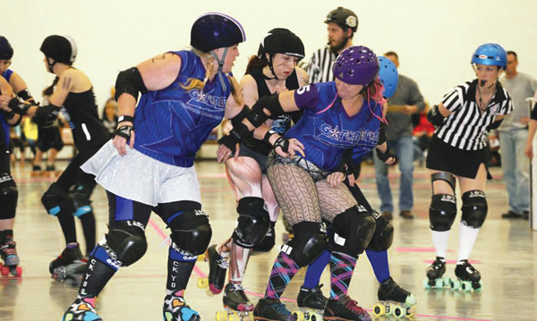 The Gastonia G Force battle it out with the Soul city Sirens. Photo Credit: Phil Lackey