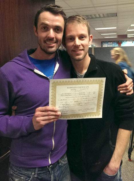 Seth Anderson and Michael Ferguson stand with their  marriage license. The couple is believed to be the first  same-sex couple to wed in Utah. Photo Credit: Seth Anderson, via Twitter, @jsethanderson