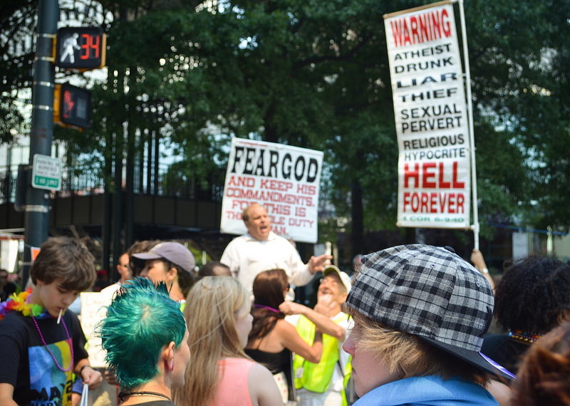 The South offers complexity in LGBT advocacy, say organizers of a weekend conference in Asheville. Pictured here, festival-goers at the state's largest LGBT Pride event in Charlotte in 2012 with anti-gay protesters in attendance. Photo Credit: Zorah Olivia, via Flickr. Licensed CC.
