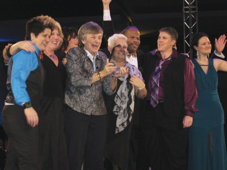 Board members for Salisbury Pride celebrate on stage after receiving the 2014 Human Rights Campaign Trailblazer Award.