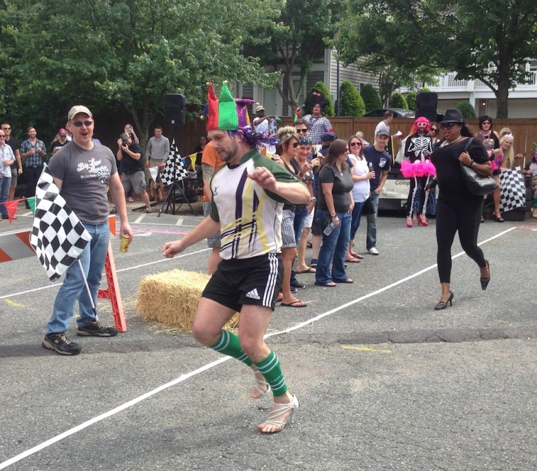 BJ Smith, president of the Charlotte Royals Rugby Football Team, takes the lead in a contest at the fifth annual Queen City Drag Race on Saturday.