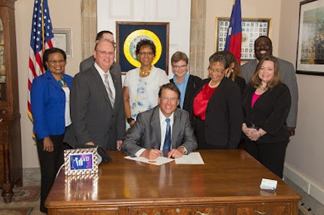 Gov. Pat McCrory signing an equal employment opportunity executive order on Monday.