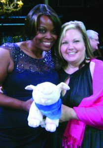 "Gwen Pearson and Barbara Green with ""Wilbur,"" the new mascot of Pearson's relaunched VisitGayCharlotte.com, at the recent Charlotte Business Guild Giving Gala in March. Photo Credit: Gwen Pearson/Facebook."