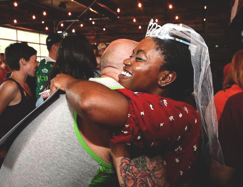Crystal Richardson of Equality NC, right, hugs Scott Lindsley at Friday's community and media event. Photo Credit: Diedra Laird, Charlotte Observer