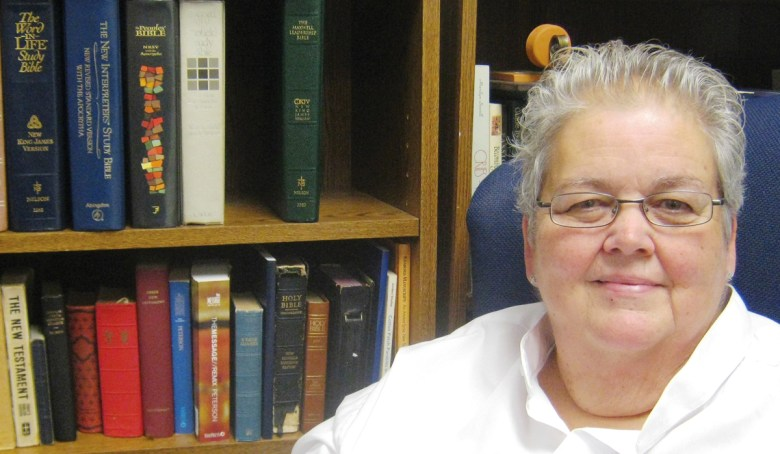 The Rev. Catherine Houchins uses vast biblical resources when she prepares for services and ministry.
