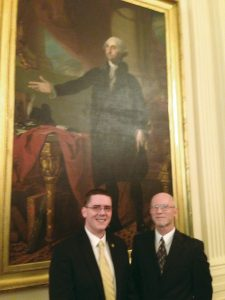 Former Editor Matt Comer, left, and Publisher Jim Yarbrough in the East Room of the White House during President Barack Obama's Pride Reception in 2013.