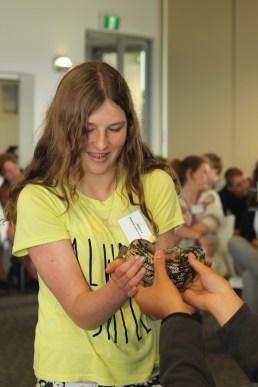 Geelong Lutheran College student Jessica holding a Blue Tongue Lizard