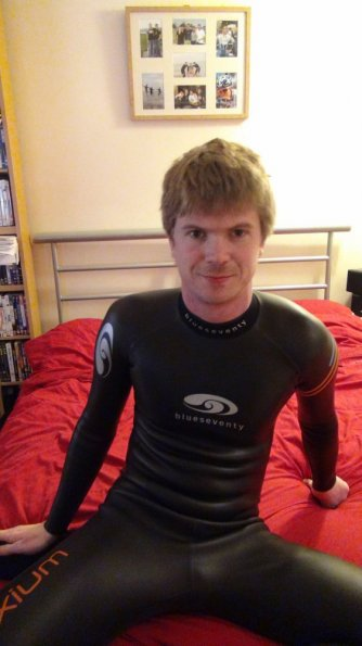 Wetsuited on bed