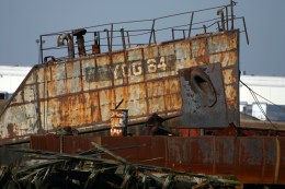 The name YOG 64 is visible on the bow of this Navy gas carrier built in 1945 and beached since 1976 in Witte's ship graveyard. (Gordon Donovan)