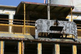 A retired Staten Island Ferry waiting to be scrapped sits docked next to a scrap metal yard. (Gordon Donovan)