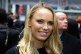 Caroline Wozniacki poses for a photo holding the Sports Illustrated swimsuit issue at the SwimCity festival in New York City on Monday Feb. 9, 2015. (Gordon Donovan/Yahoo News)