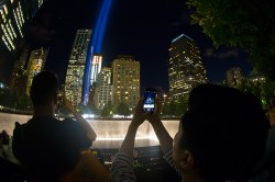 "A visitor takes a photo with his smart phone of ""The Tribute in Light"" at the National September 11 Memorial & Museum on Friday, Sept. 11, 2015. It was the 14th anniversary of the Sept. 11 terror attacks on Friday. (Gordon Donovan/Yahoo News)"