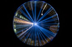 "In a photo taken with a fish eye lens, the two beams of light meet in the art installation ""The Tribute in Light"" projecting in the night sky over Manhattan on Sept. 11, 2015. (Gordon Donovan)"