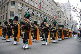 Members of the New York City Police Department Emerald Society march in the St. Patrick's Day parade past protesters, March 17, 2015, in New York. (Gordon Donovan)