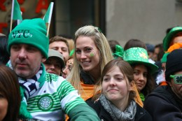 A young woman showing her Irish hertitage with a shamrocks on her cheek enjoys the St. Patrick's Day Parade, March 17, 2015, in New York. (Gordon Donovan)