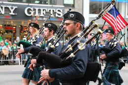 A member of the Westchester Plumbers and Steamfitters local play the bagpipes while marching Fifth Ave. during the St. Patrick's Day Parade, March 17, 2015, in New York. (Gordon Donovan)