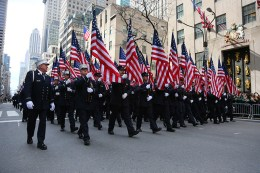 Members of FDNY Emerald Society carrying flags make their way onto Fifth Ave. during the St. Patrick's Day Parade, March 17, 2015, in New York. (Gordon Donovan)