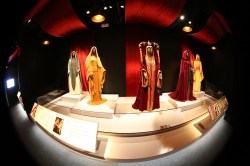 """""""The Phantom Menace"""" costumes were inspired by the art of the Pre-Raphaelites — 19th-century English painters — who had particular visions of heroines and female beauty. Their use of rich color influenced the fashions of Padmé's handmaidens and the citizens of Naboo. (Gordon Donovan/Yahoo News)"""