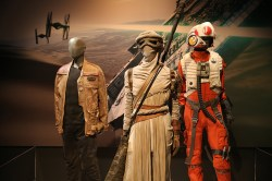 The costumes of cast members from the new Star Wars, The Force Awakens. From left to right: Finn, a trained warrior desperate to escape his past. Finn is plunged into adventure as conscience drives him down a heroic, but dangerous path. Rey is resilient survivor, a scavenger toughened by a lifetime of dealing with cutthroats of the harsh desert world of Jakku. Pilots of the Resistance soar into battle against the evil First Order behind the controls of a modern X-wing fighter. (Gordon Donovan/Yahoo News)