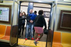 Passengers get a laugh as they board the subway as people take part in the No Pants Subway Ride in New York City, Sunday, Jan. 10, 2016. The No Pants Subway Ride began in 2002 in New York as a stunt and has taken place in cities around the world since then. (Gordon Donovan/Yahoo News)