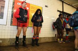 Passengers wait for the subway as they take part in the No Pants Subway Ride in New York City, Sunday, Jan. 10, 2016. The No Pants Subway Ride began in 2002 in New York as a stunt and has taken place in cities around the world since then. (Gordon Donovan/Yahoo News)