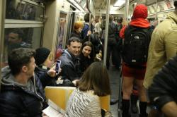 A passenger on the subway takes a photo of people participating in the No Pants Subway Ride in New York City, Sunday, Jan. 10, 2016. (Gordon Donovan/Yahoo News)