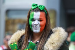 A young woman with her face painted in the colors of the flag of Ireland watches the St. Patrick's Day Parade on March 17, 2016, in New York. (Gordon Donovan/Yahoo News)