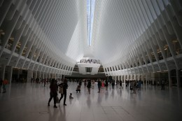 People walk through the Oculus mall at World Trade Center on Monday, August 22, 2016. It stretches along a four-block underground network that spans the bases of three office towers. While mostly below street level, light beams in through the windows of the winged Oculus, designed by Santiago Calatrava, that top the transportation hub of 13 subway trains and river ferries. (Gordon Donovan/Yahoo News)