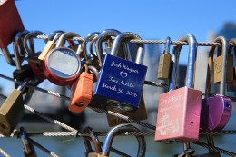 Visitors have been attaching locks with sentimental messages to railings like these on the Brooklyn waterfront as symbolic acts of affection. (Gordon Donovan/Yahoo News)