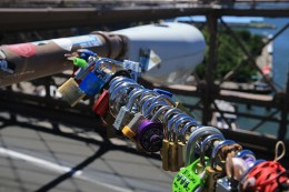 A wide variety of padlocks symbolizing love are attached to light posts on the Brooklyn Bridge on August 23, 2016. (Gordon Donovan/Yahoo News)