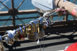Love padlocks attached to light posts on the Brooklyn Bridge on August 23, 2016. (Gordon Donovan/Yahoo News)