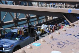 Traffic moves along below the love padlocks on the Brooklyn Bridge on August 23, 2016. (Gordon Donovan/Yahoo News)