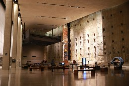 Foundation Hall is a room of massive scale, with ceilings ranging from 40 to 60 feet and nearly 15,000 square feet of floor space. Visitors see a portion of the slurry wall, a surviving retaining wall of the original World Trade Center that withstood the devastation of 9/11. Against this backdrop, the Last Column stands 36-feet high and is covered with mementos, memorial inscriptions, and missing posters placed there by ironworkers, rescue workers and others. (Photo: Gordon Donovan/Yahoo News)