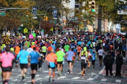 A pack of runners reach First Ave. just past mile 16 of the 2016 New York City Marathon, Nov. 6, 2016. (Gordon Donovan/Yahoo News)