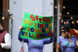 People hold up placards to support friends running in the 2016 New York City Marathon, Nov. 6, 2016. (Gordon Donovan/Yahoo News)