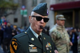A veteran enjoys a good cigar as he marches up Fifth Avenue during the Veterans Day parade in New York City on Nov. 11, 2016. (Gordon Donovan/Yahoo News)