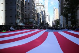 An American flag is draped across Fifth Avenue during the Veterans Day parade in New York on Nov. 11, 2016. (Gordon Donovan/Yahoo News)