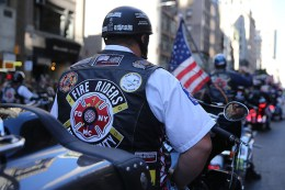 A member of the Fire Riders rides a motorcycle up Fifth Avenue during the Veterans Day parade on Fifth Avenue in New York on Nov. 11, 2016. (Gordon Donovan/Yahoo News)