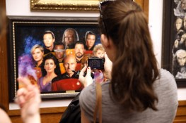 "Visitors take photos of the original art from the exhibit ""Star Trek: 50 Artists. 50 Years."" (Photo: Gordon Donovan/Yahoo News)"